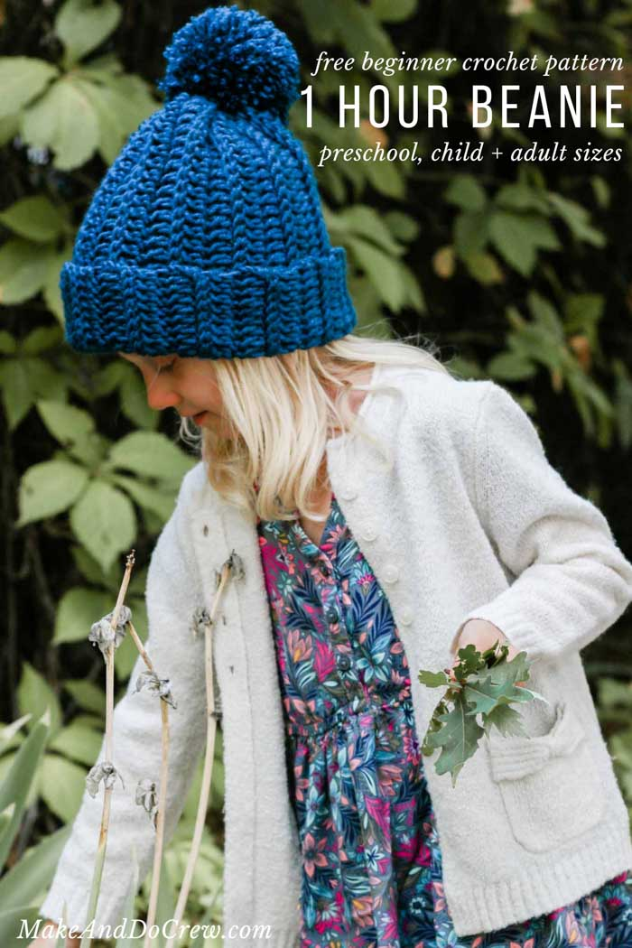Easy beginner-friendly ribbed crochet beanie with a pom pom on a child playing outside. Free pattern and tutorial.