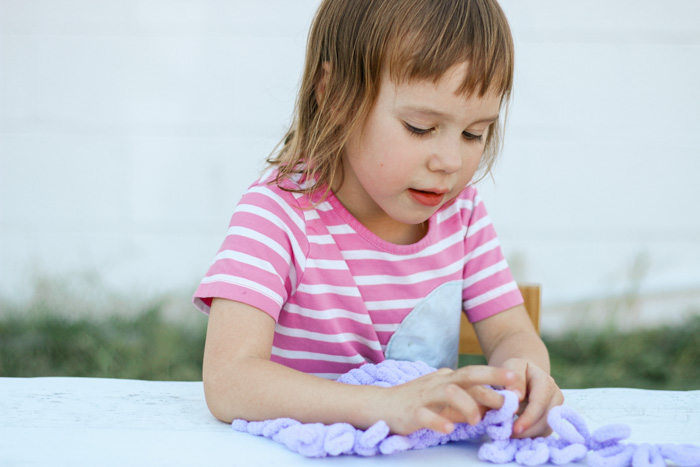 Finger knitting is a wonderful fidget idea for kids with adhd or sensory processing disorder.