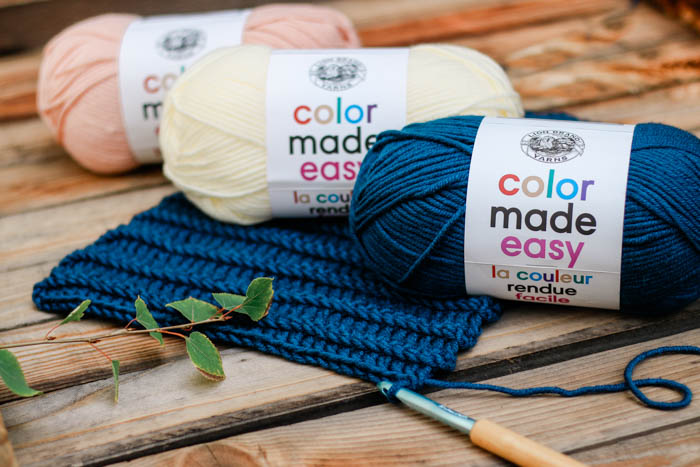 Lion Brand Color Made Easy yarn in Millennial, Huckleberry and Alabaster.