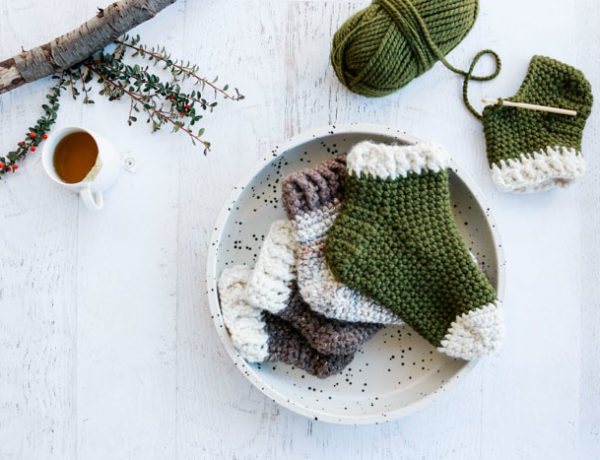 Free Pattern: These simple crochet slipper socks for adults make a perfect crochet gift idea for men and women alike. The chunky yarn gives them plenty of warmth, squish and durability and allows you to make a pair fast!