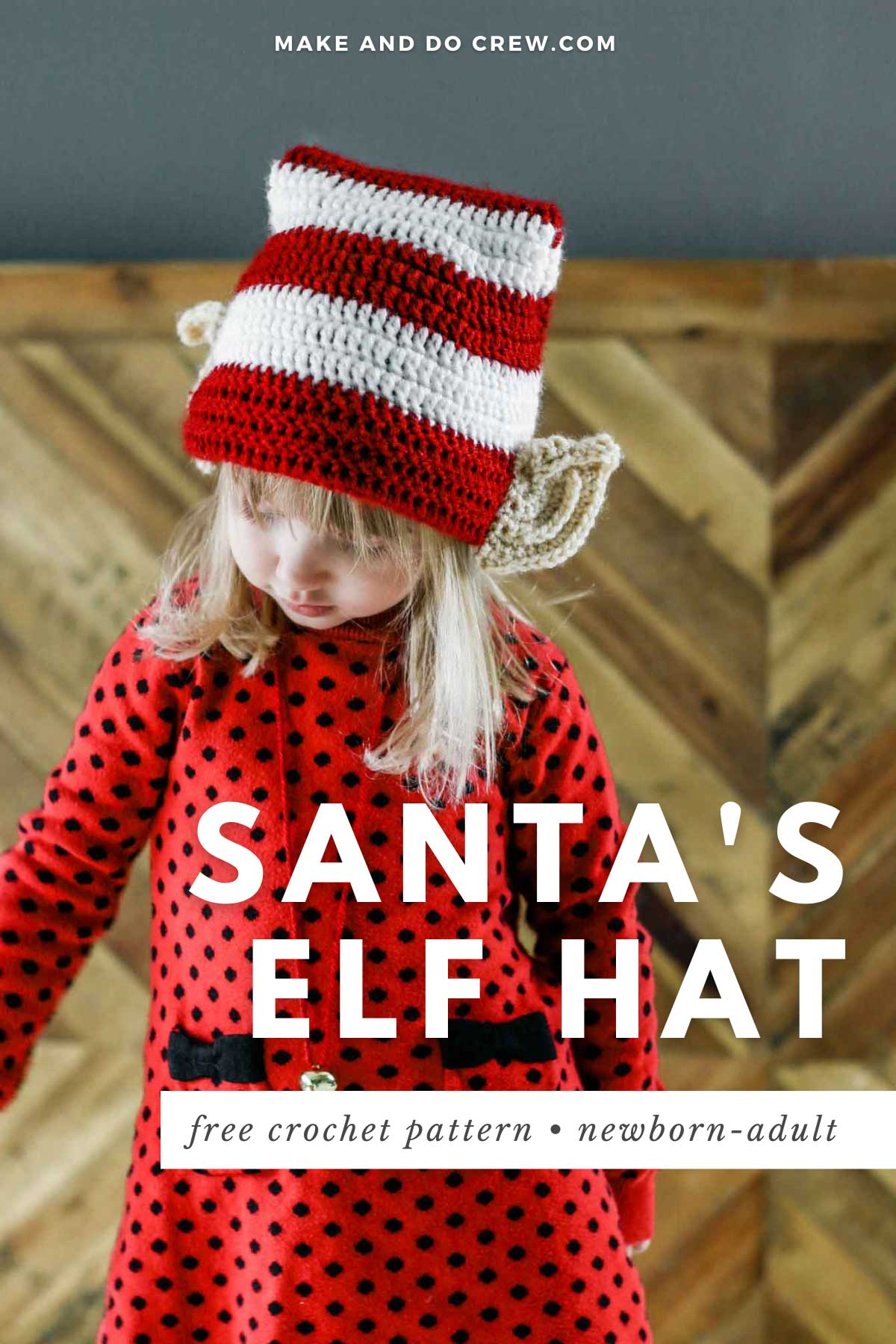 A girl wearing a crocheted Santa's elf hat with crocheted ears.