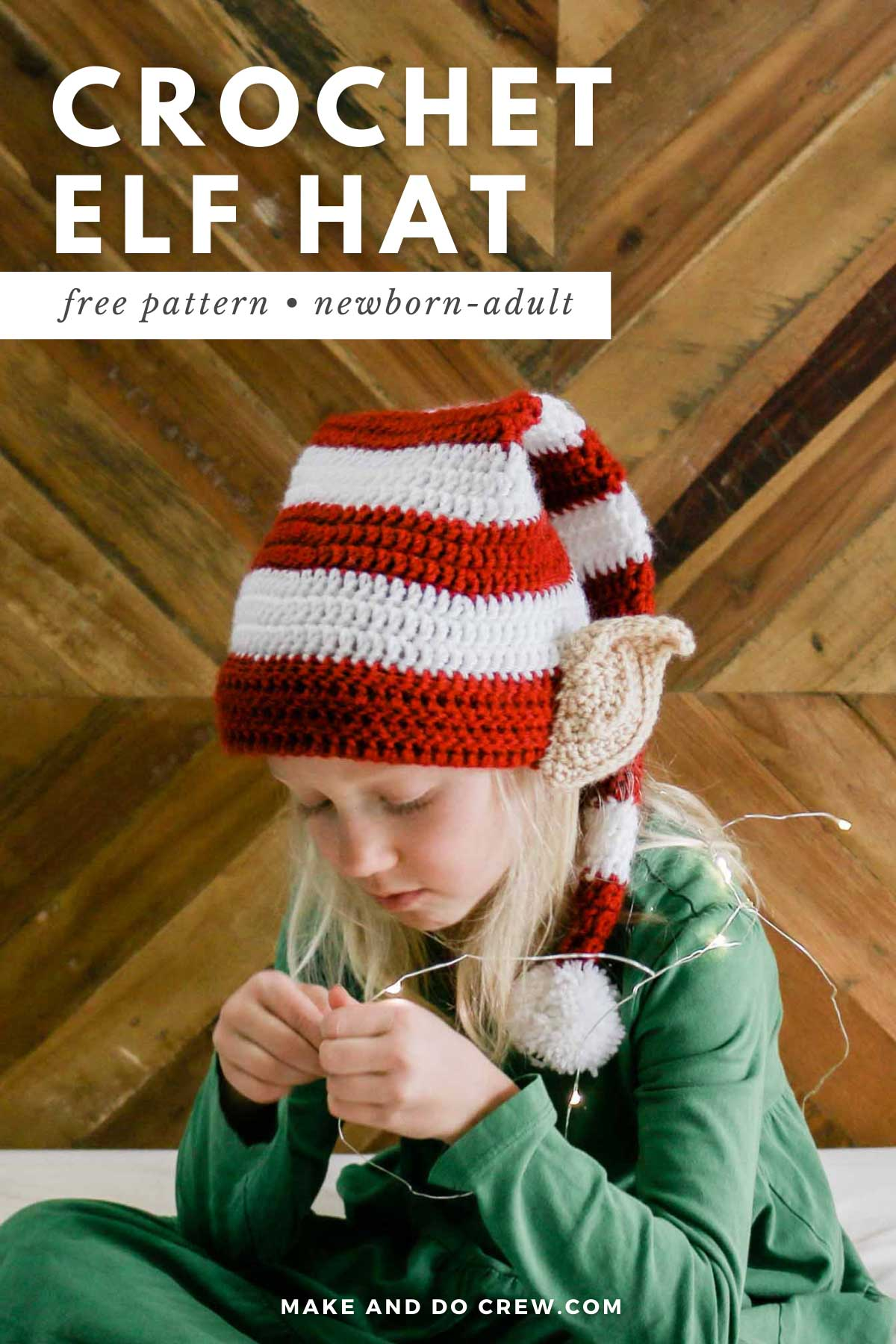 A girl wearing a crocheted Santa's elf hat with realistic looking crocheted ears.