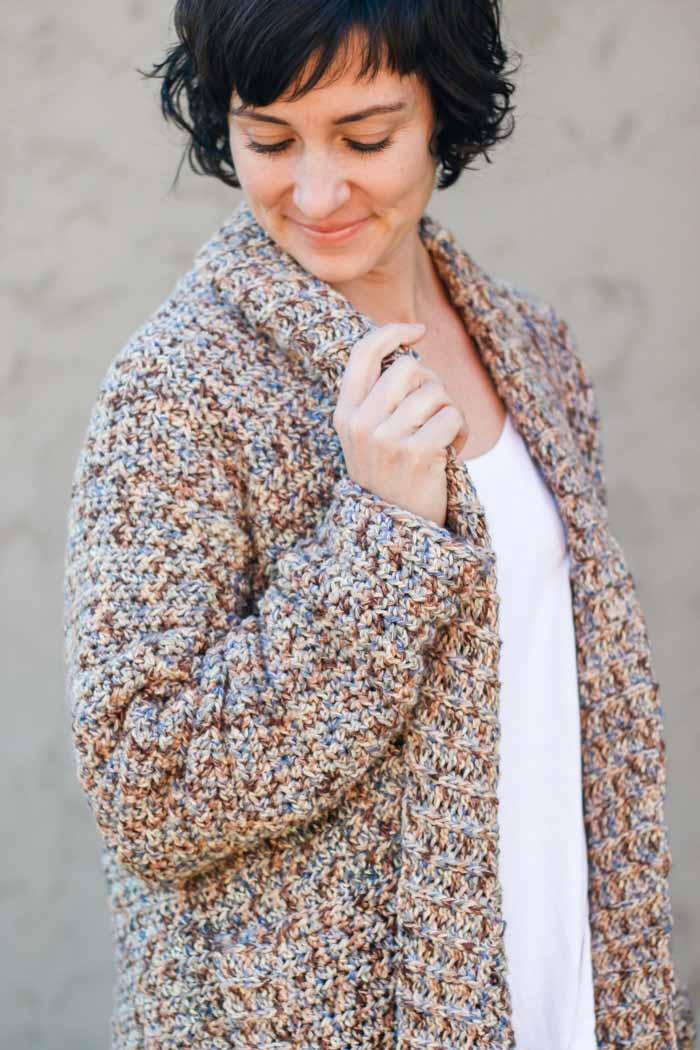 This cotton rolled collar cardigan is a perfect free crochet pattern for beginners! You won't believe how easy this sweater is. Video tutorial included.