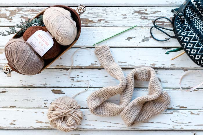 """Free crochet twist headband pattern featuring Lion Brand LB Collection Baby Alpaca yarn in the color """"tan""""."""