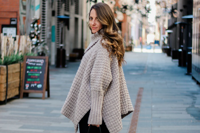 In this crochet poncho video tutorial, learn how to use simple rectangles to construct a cozy crochet poncho sweater with sleeves. These step-by-step instructions are very beginner friendly. Follow along with the free written pattern that includes plus sizes!