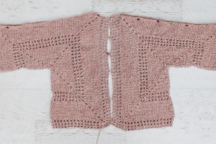Tutorial describing how to make a crochet hexagon sweater including how to seam the hexagons together.