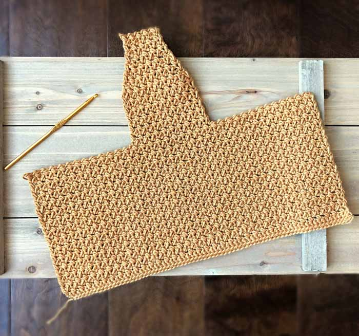 This easy crochet baby bonnet pattern is beginner friendly and made from a simple rectangle.