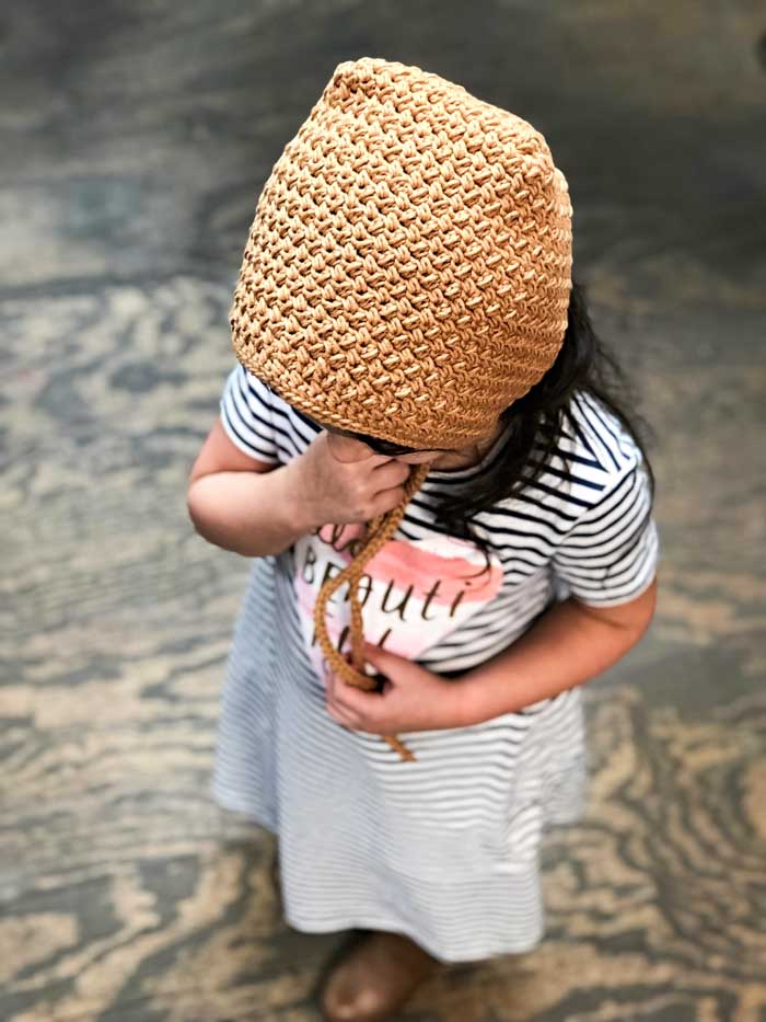 Beginner-friendly, modern crochet bonnet free pattern and tutorial. Sizes newborn-6 years.