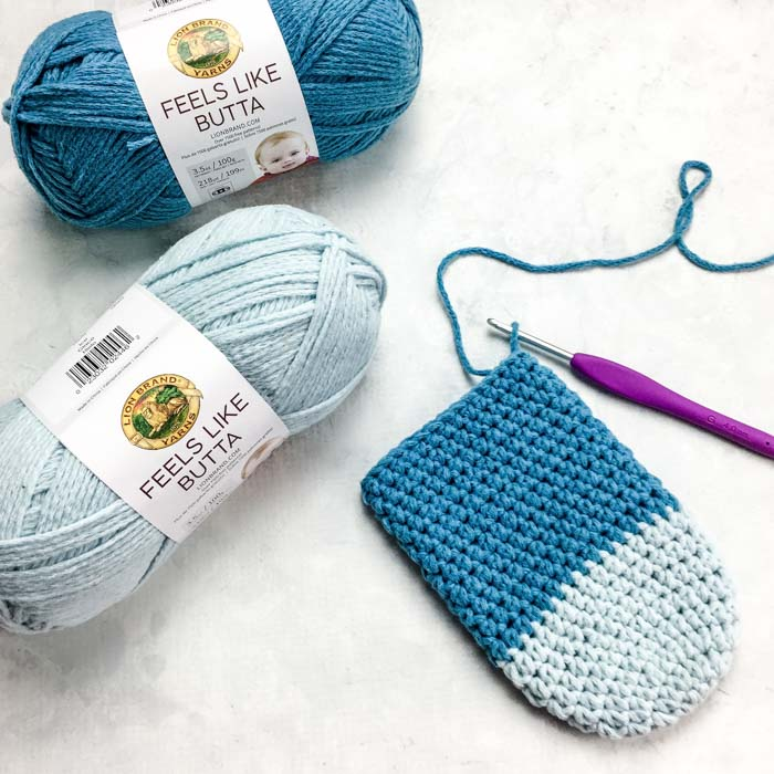 Free easy crochet slipper socks pattern and tutorial featuring Lion Brand Feels Like Butta yarn.
