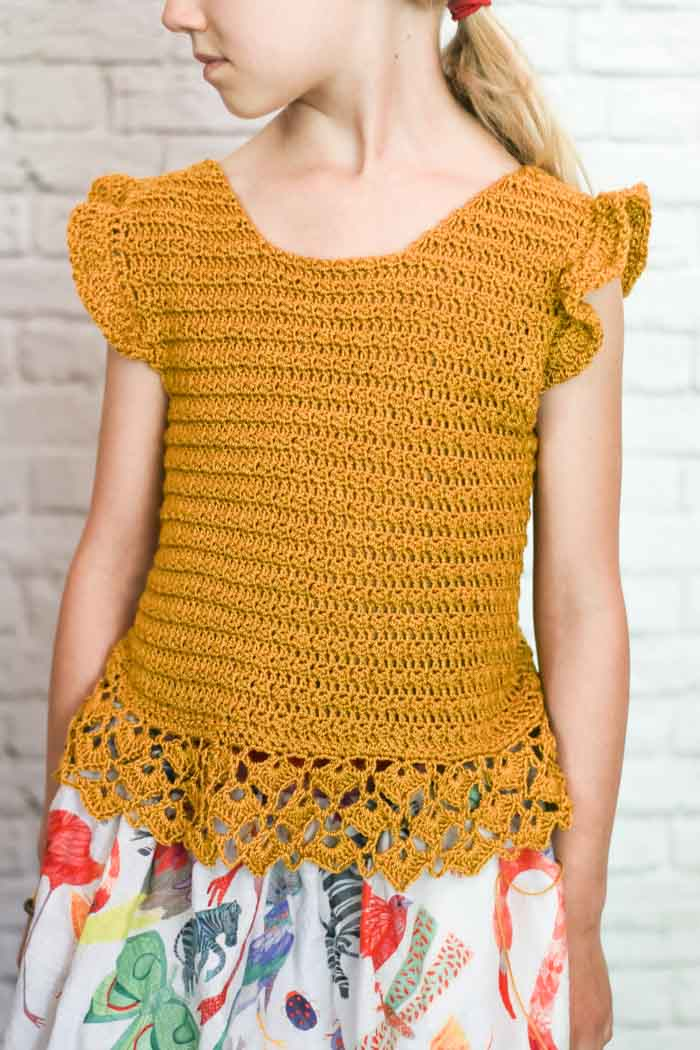Crochet top for girls with flutter sleeves made with Lion Brand Beautiful You yarn. Video tutorial!