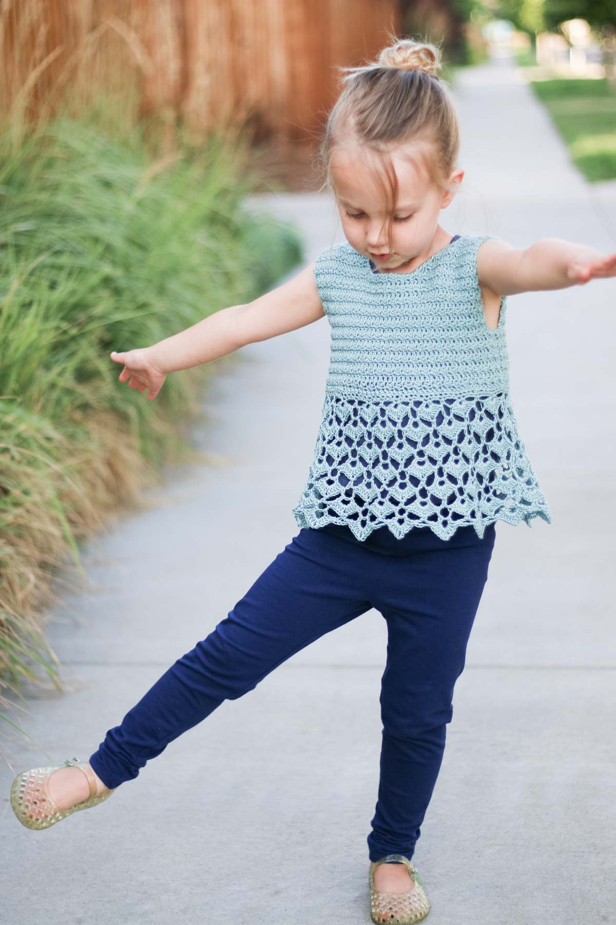 This kids crochet tank top pattern is easy to make into a dress too. Follow the free pattern and video tutorial to learn how!