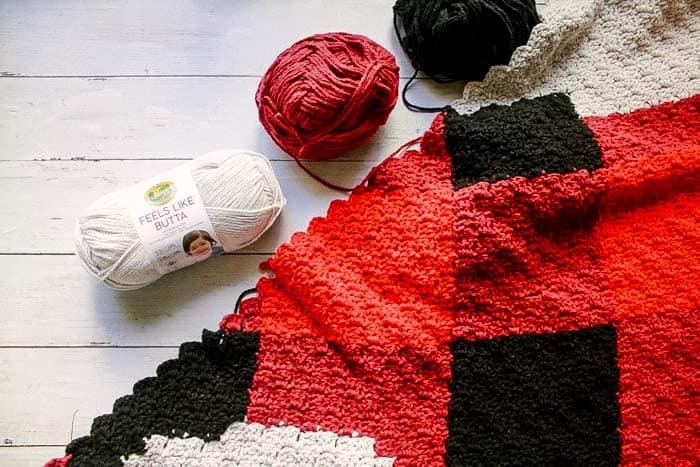 Work in progress buffalo plaid corner to corner crochet afghan using Lion Brand Feels Like Butta yarn.