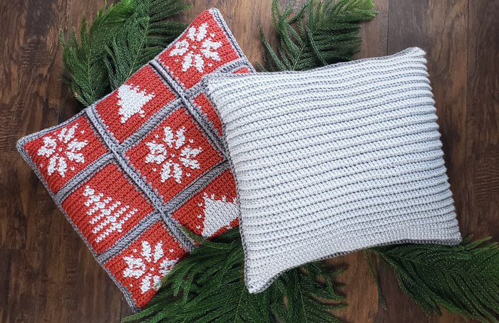 Christmas pillows made of individual crochet squares. Each square has a winter image. These holiday pillows are made by tapestry crochet with Lion Brand Yarn. Free pattern + tutorial.