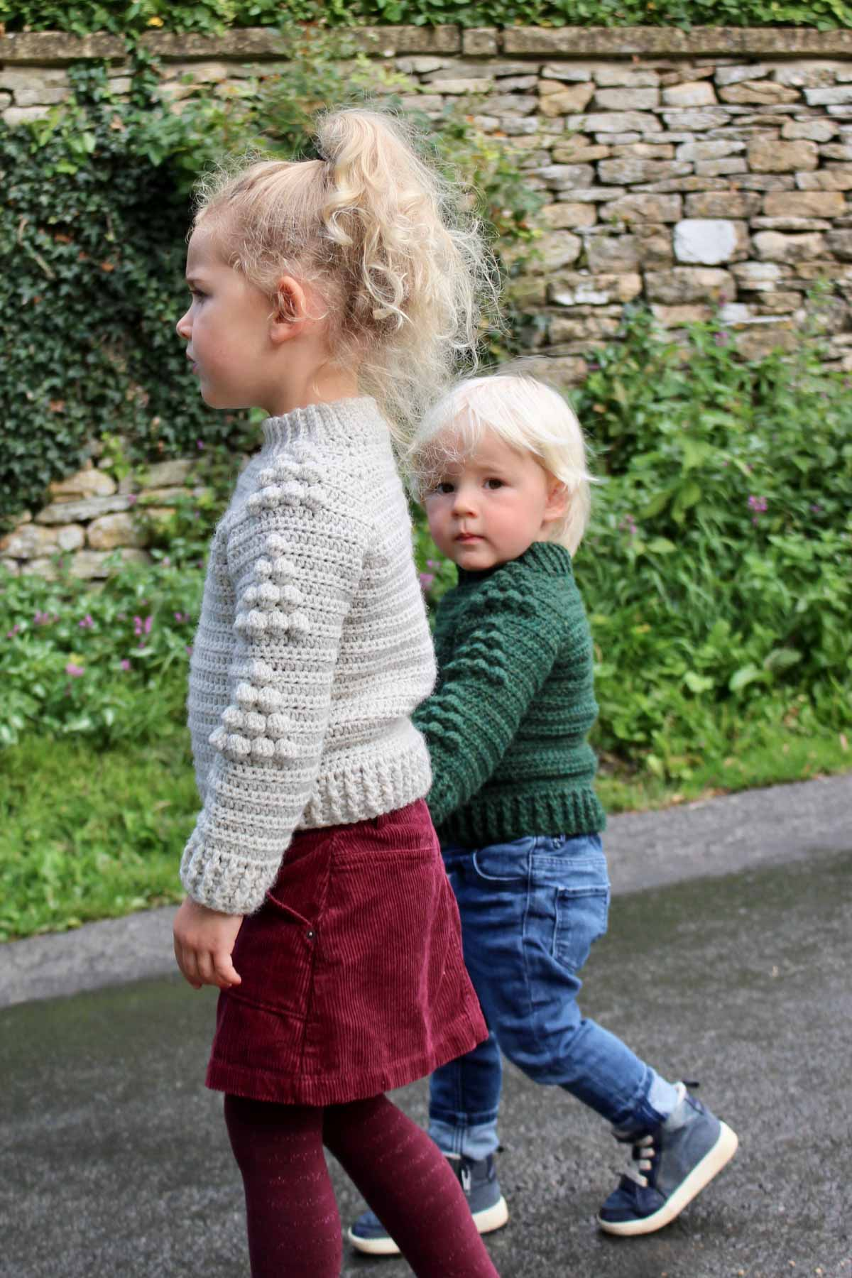 is raglan crochet baby sweater is equal parts cute and cozy--a modern take on a classic children's pullover sweater. Get the free pattern in sizes 6 months-10 years featuring Lion Brand Wool-Ease.