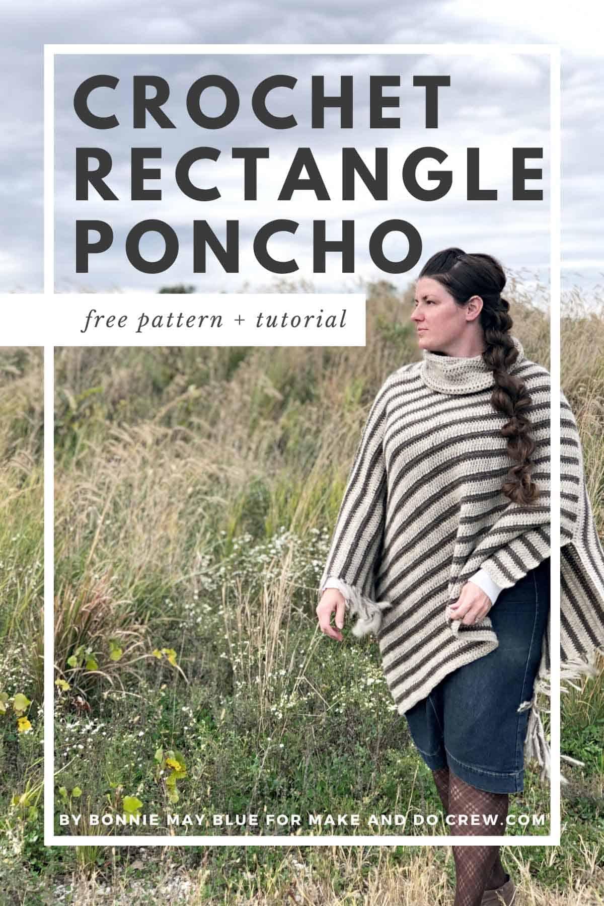 Woman wearing a crochet poncho with fringe standing in an open field.