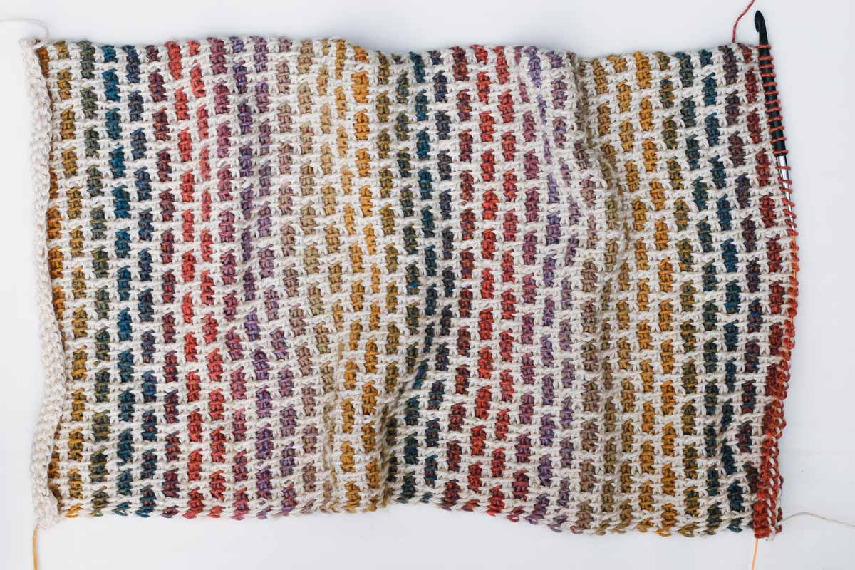 The Tunisian crochet brick stitch using Lion Brand Ferris Wheel yarn in the color Buttercup and Heartland yarn in the color Acadia. Really interesting Tunisian crochet stitch to make beautiful, muted rainbow hues.