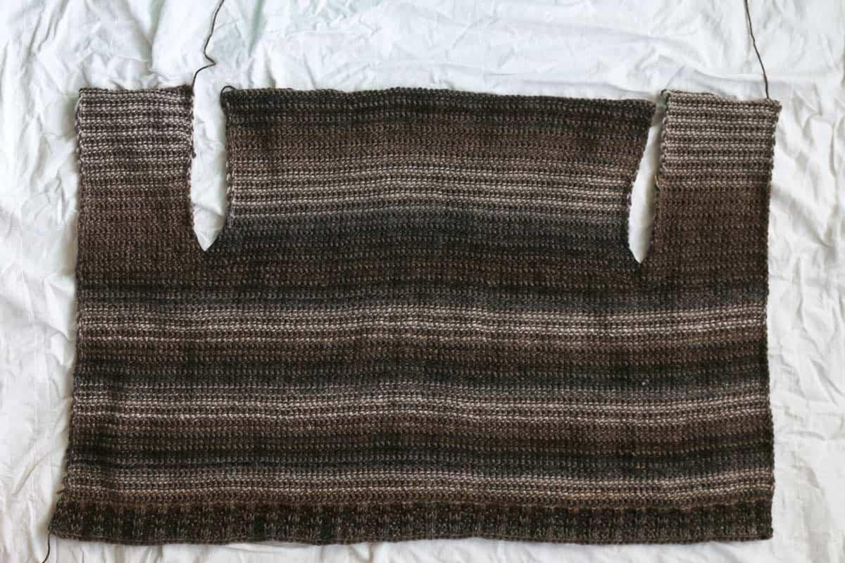 In progress beginner Tunisian crochet cardigan pattern worked in one piece.