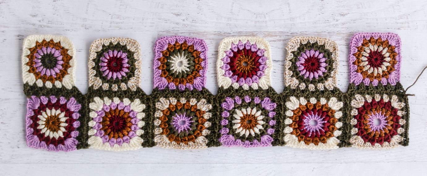 Vibrant crochet granny squares being joined as you go.