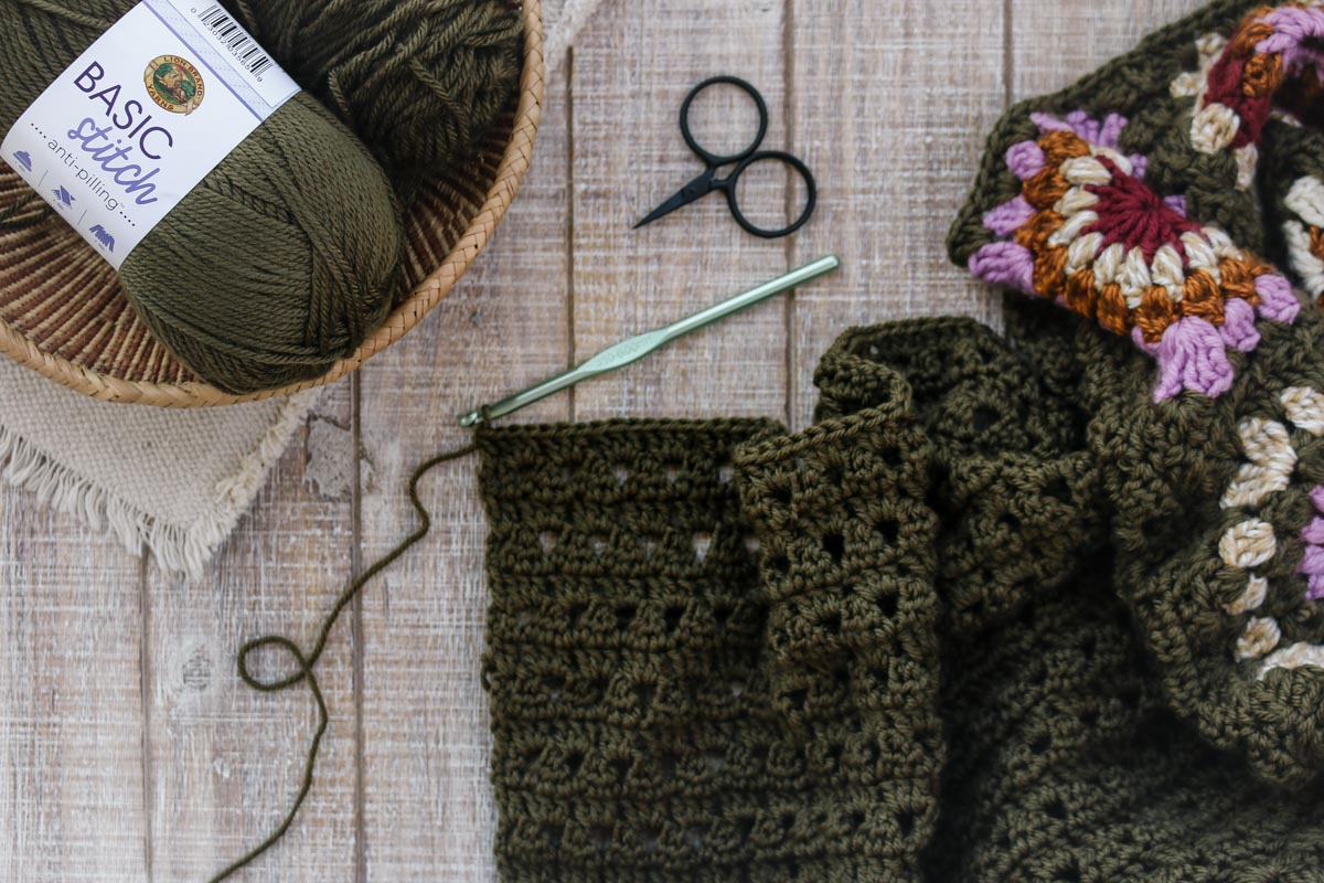 An in progress crochet granny square sweater pattern being made with Lion Brand Basic Stitch Anti-Pilling yarn.