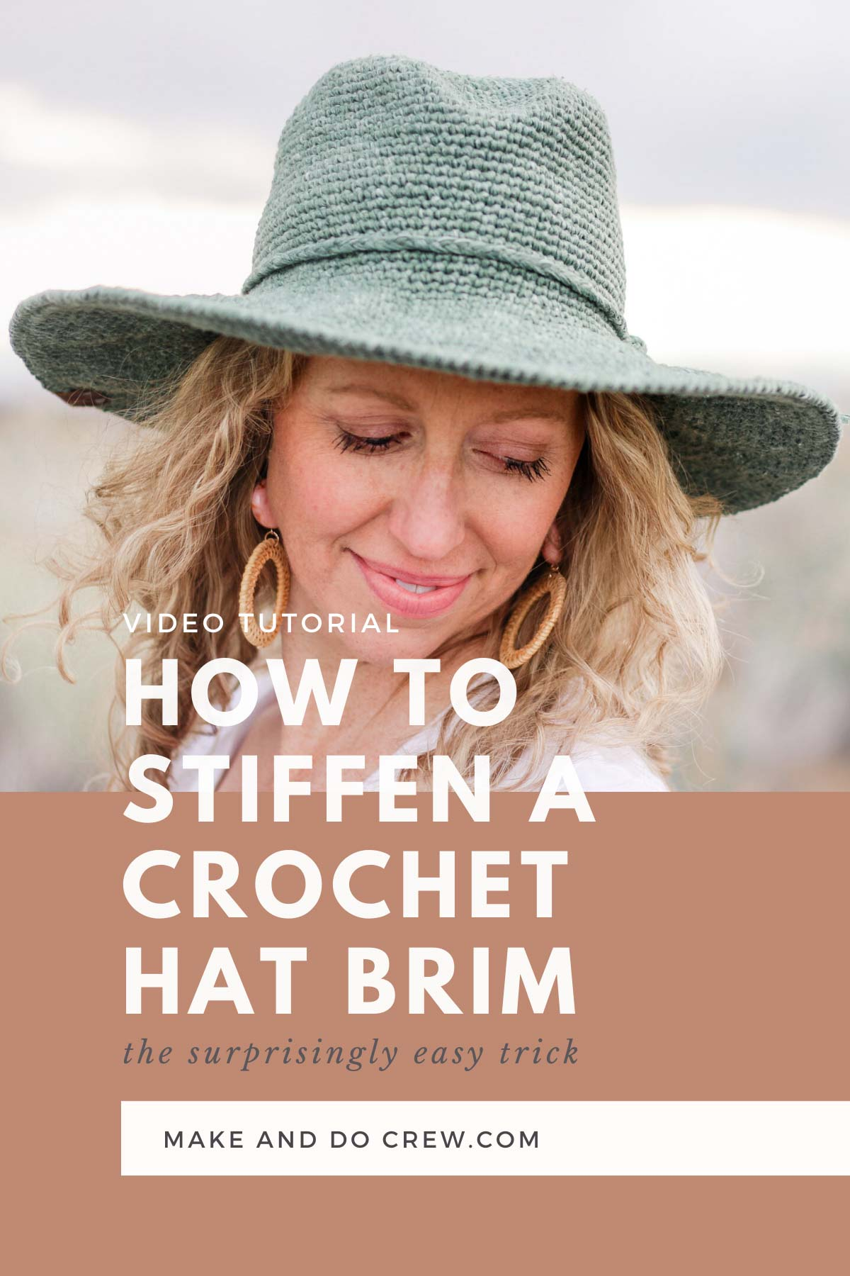 A blonde woman wearing a crochet sun hat made from the Cleo Fedora free crochet pattern.