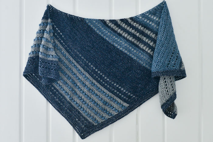 This asymmetrical scarf is made with Lion Brand Jeans yarn using the horizontal puff stitch, creating a unique texture and beautiful drape. Free pattern and tutorial.
