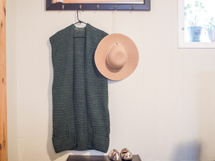 This long crochet vest features an open work tree pattern along the bottom edge, making it the perfect transitional sleeveless cardigan for Fall. Free pattern + tutorial.