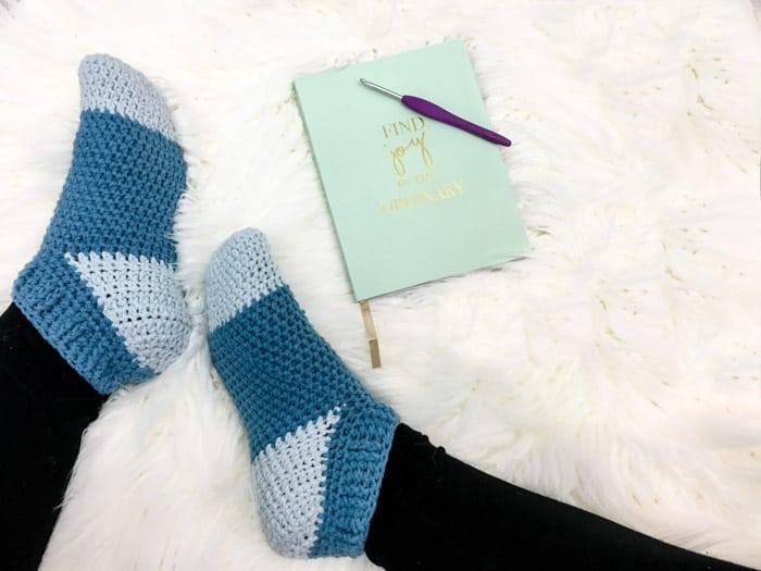 Free crochet pattern + tutorial for easy slipper socks, using Lion Brand Yarn Feels Like Butta.