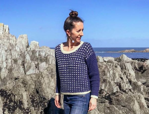 A wool crochet fisherman's sweater pattern with a modern tapestry pattern that's easy enough for tapestry beginners. Free pattern featuring Lion Brand yarn.