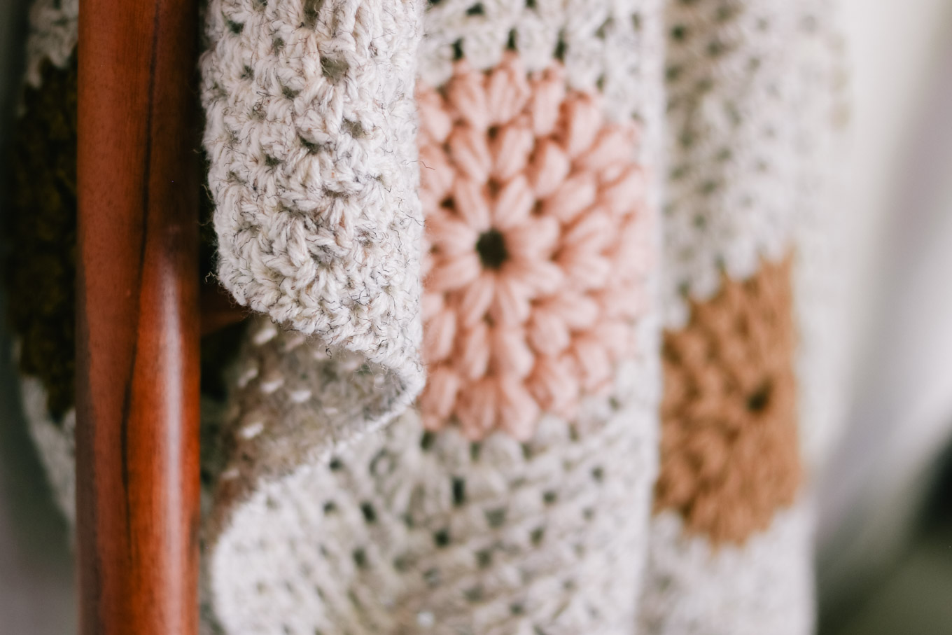 Closeup of crochet blanket edge worked with the crochet crab stitch (aka reverse single crochet).