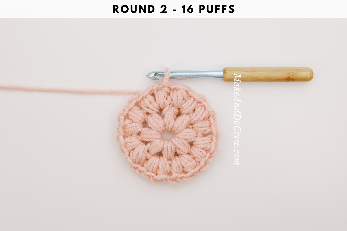 Round 2 of a crochet puff stitch circle.