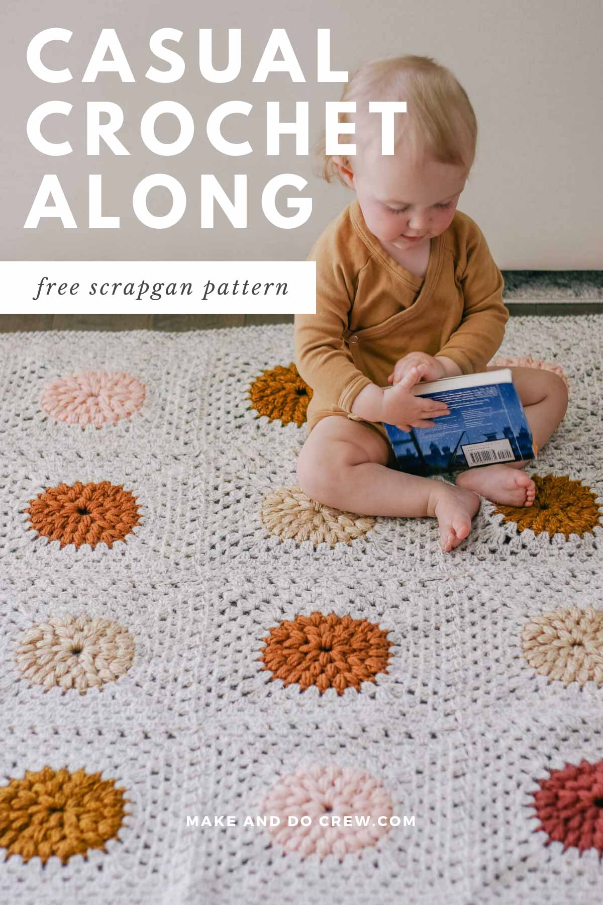 Baby sitting on a modern crochet granny square blanket made with Lion Brand Wool Ease yarn scraps.