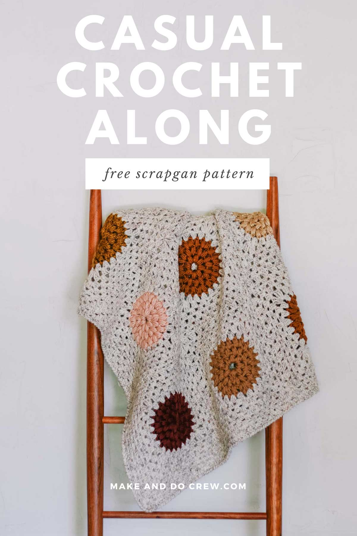A join as you go crochet granny square blanket draped over a mid century modern ladder.