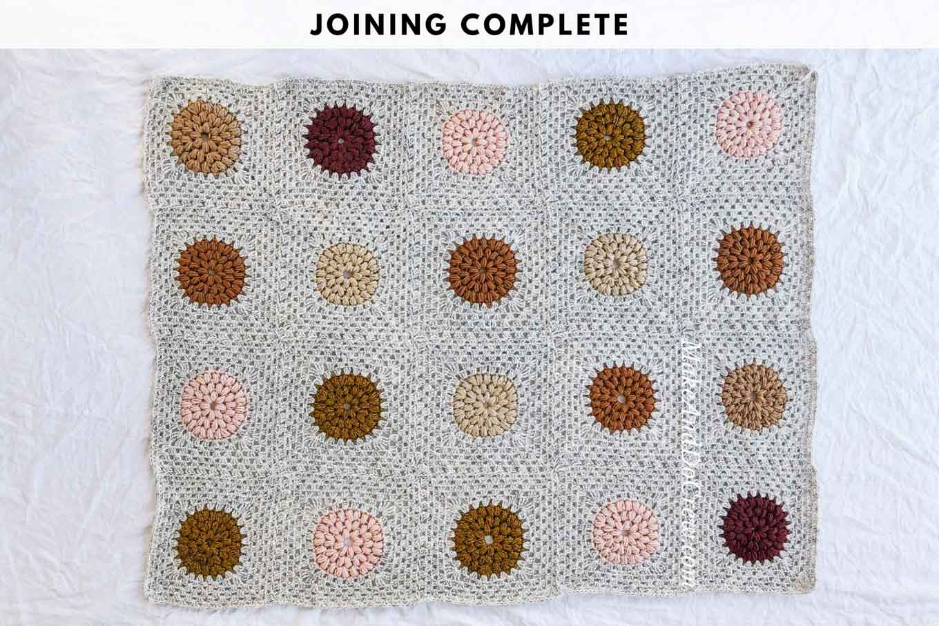 A crochet granny square blanket made from puff stitch circles.