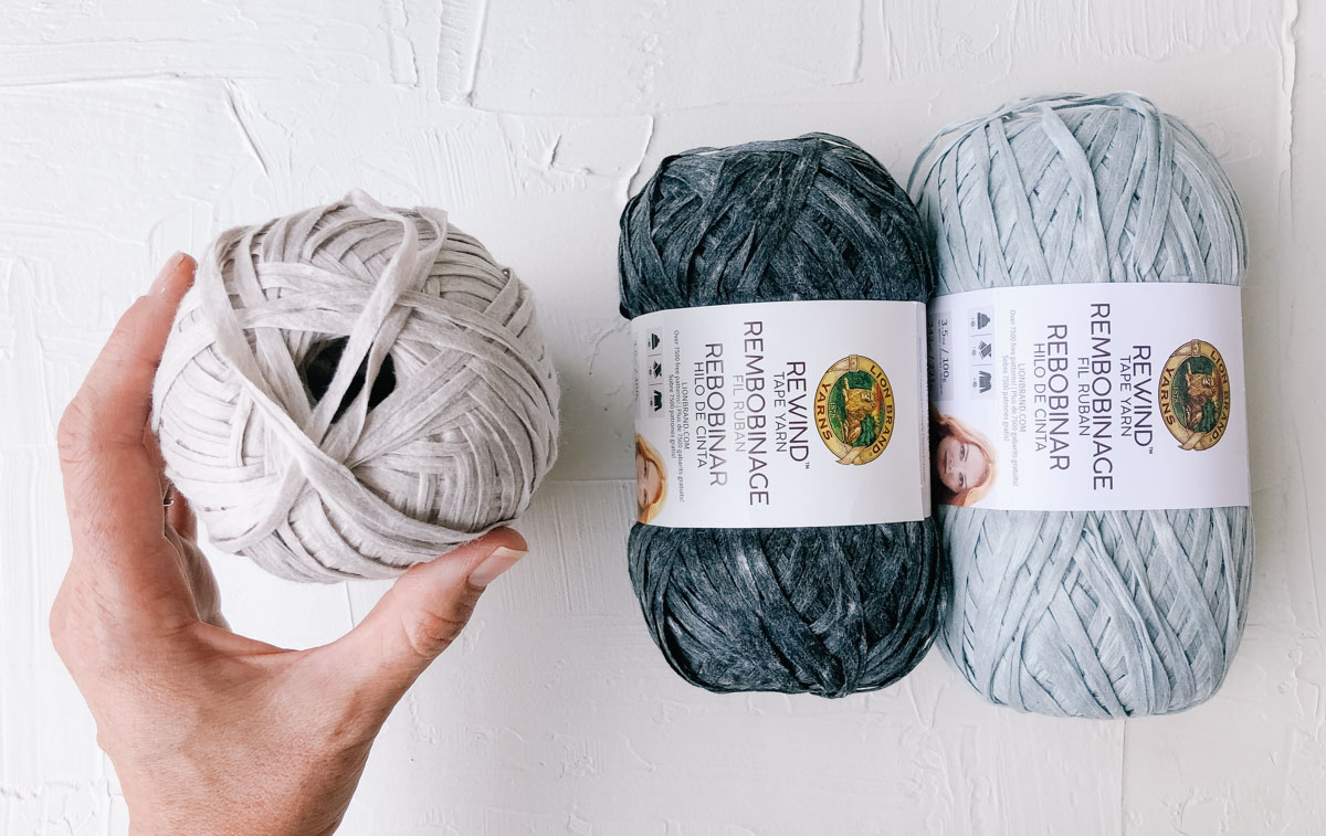 Three skeins of Lion Brand Rewind yarn that are perfect to use for free crochet patterns like the Cleo Fedora.