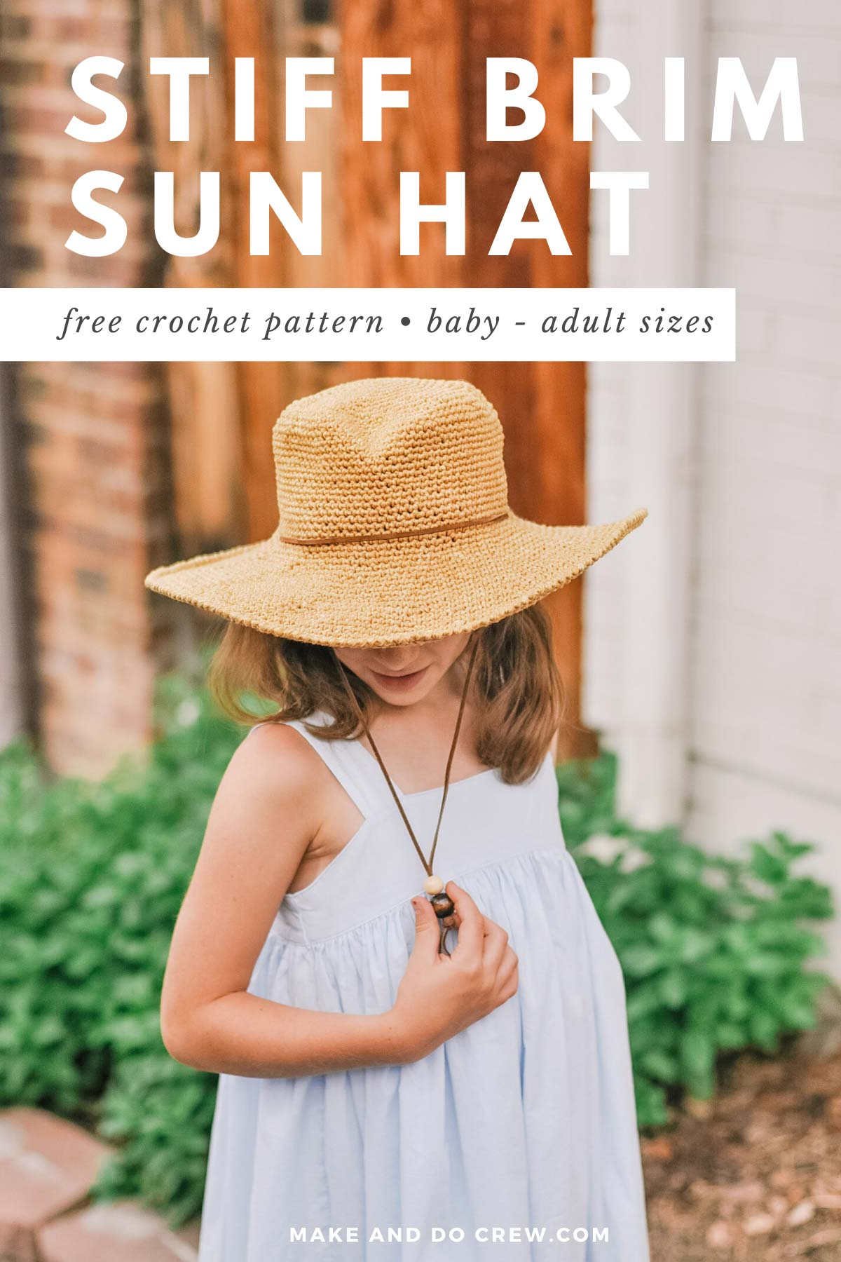 Young girl wearing the Cleo Fedora, a free crochet sun hat pattern for kids designed by Make & Do Crew.