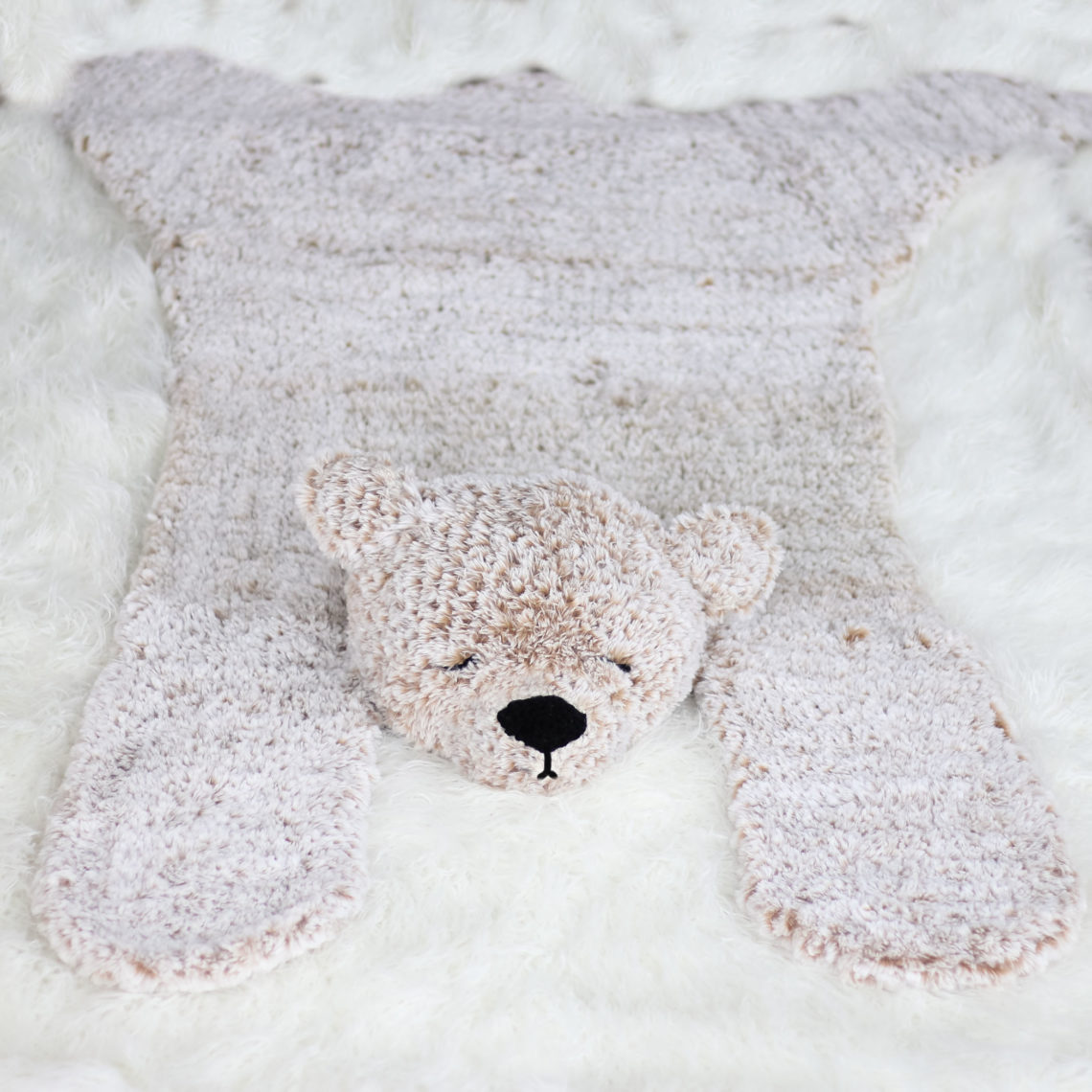A crocheted faux fur bear rug made from Lion Brand Go for Faux in the color Blonde Elk.