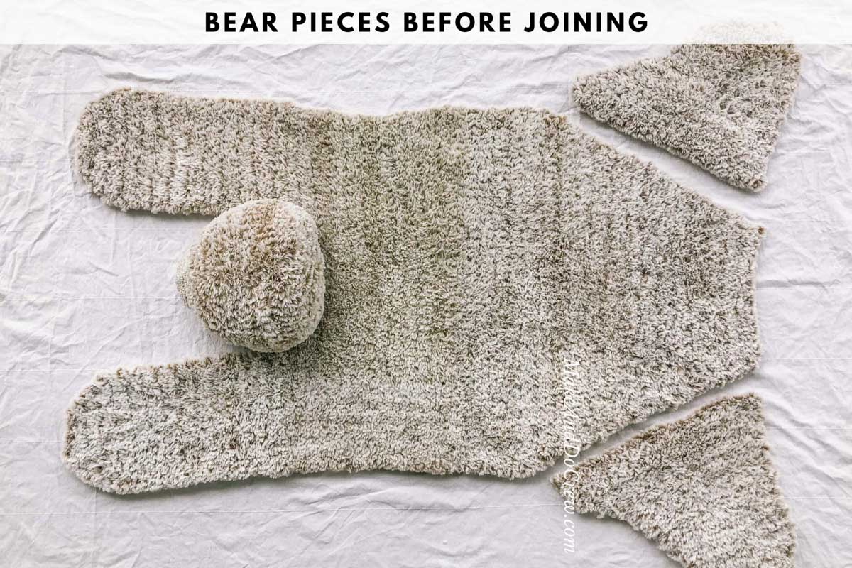An overhead view of a crochet bear rug made with furry Lion Brand Go For Faux yarn.