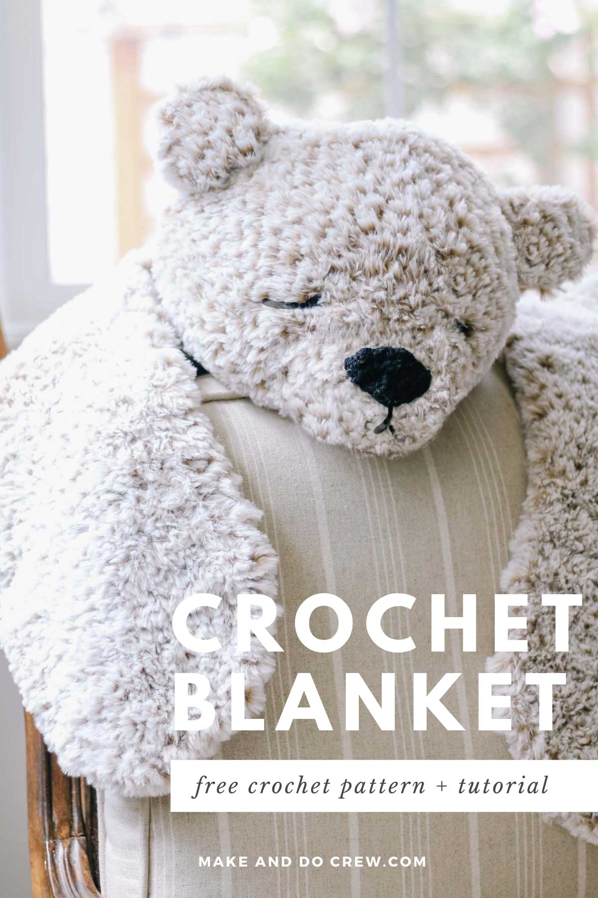 A crocheted bear skin blanket made from Lion Brand Go For Faux yarn draped over a chair.
