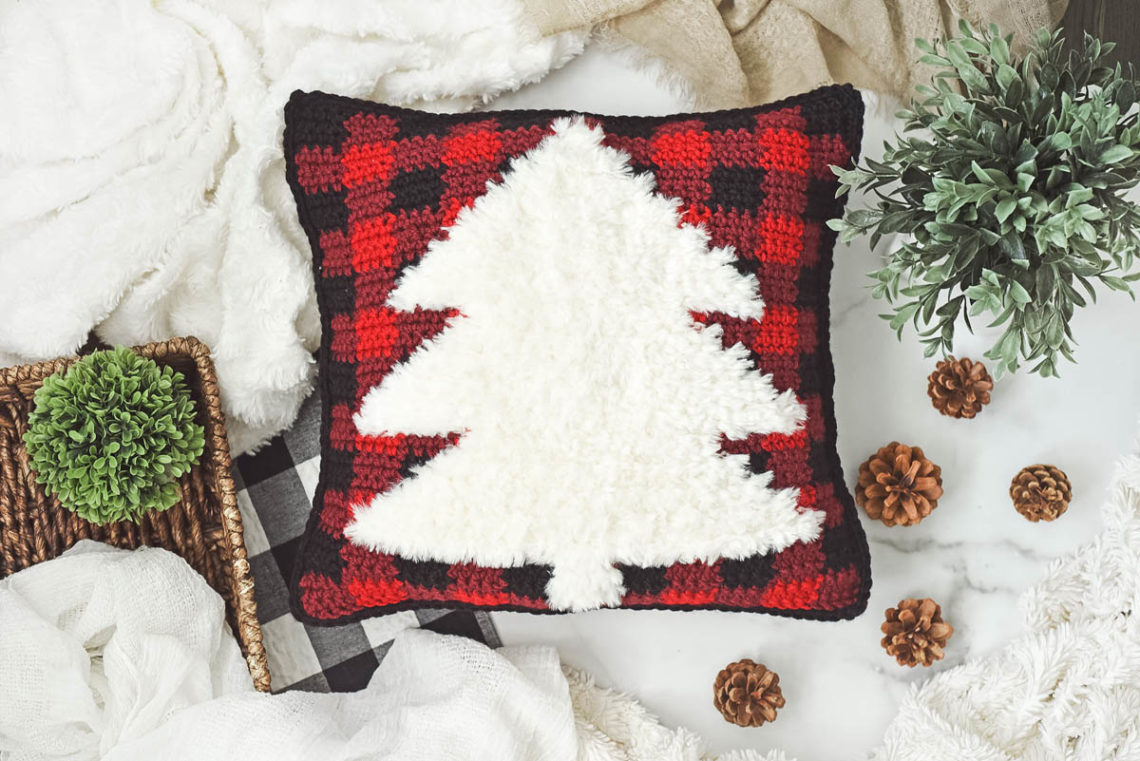 Buffalo plaid crochet Christmas pillow pattern with a faux fur tree. (Color Made Easy + Go For Faux yarn.)