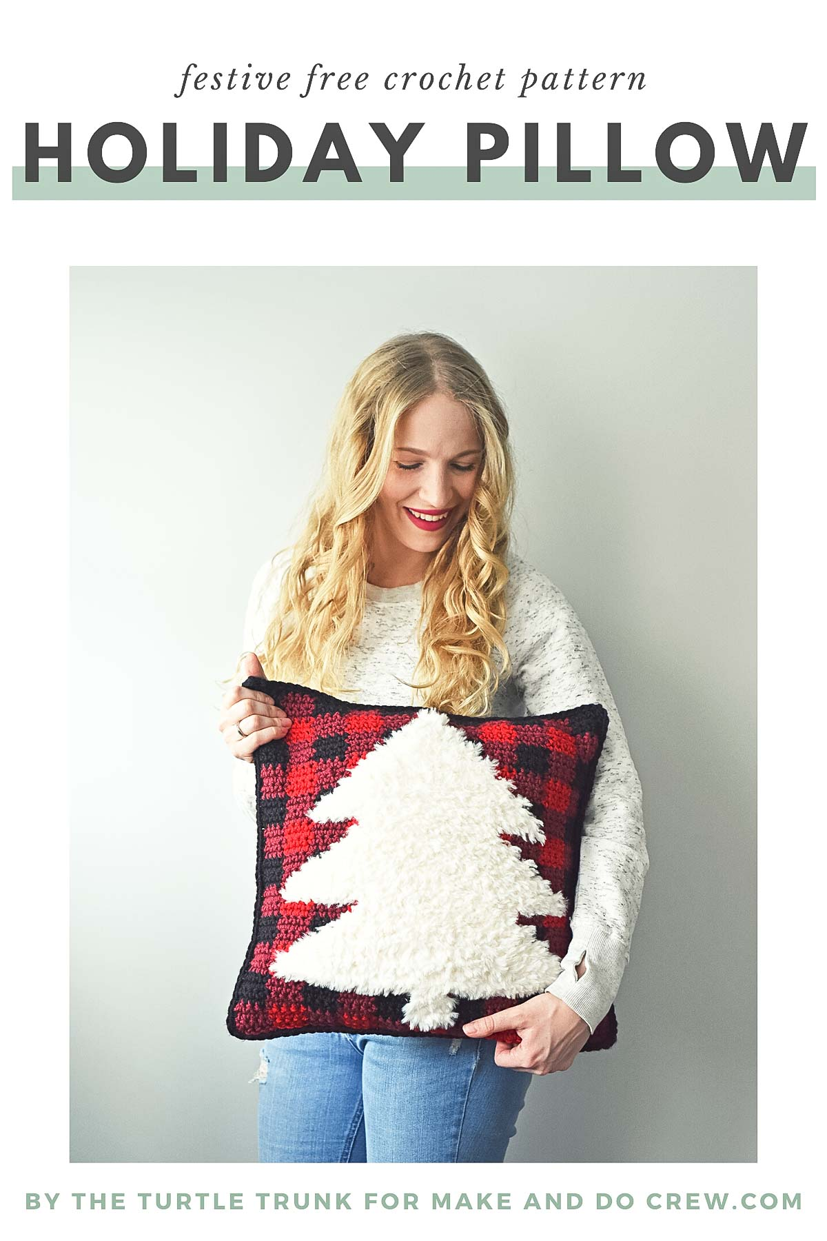 Blonde woman holding a furry crochet buffalo plaid Christmas pillow.