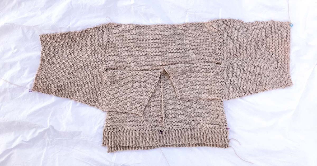 A work in progress crochet sweater pattern with unique construction.