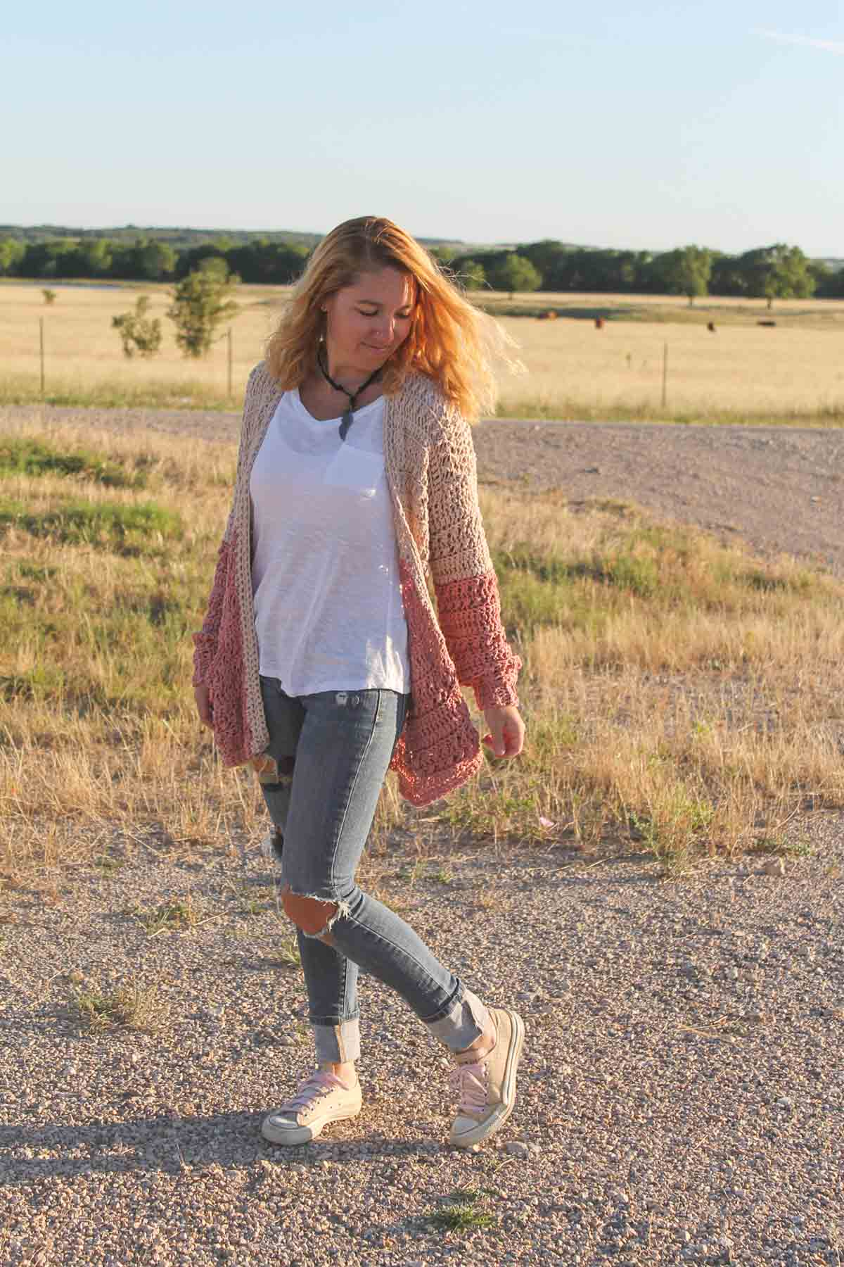 Woman wearing a boho crochet color block cardigan made with beginner stitches.