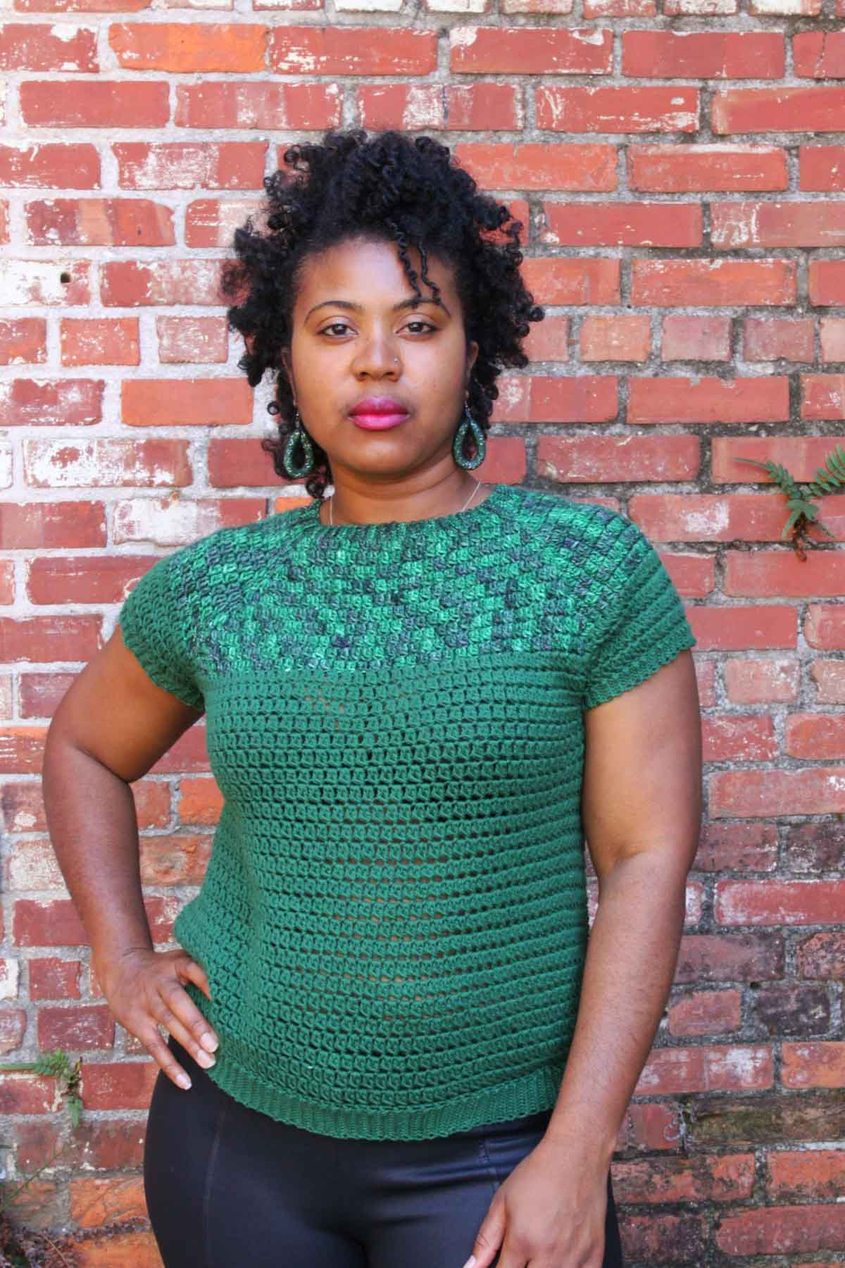 Nkese Lewis, pictured here wearing a green crochet summer top, provides tips on how to become a crochet pattern tester.