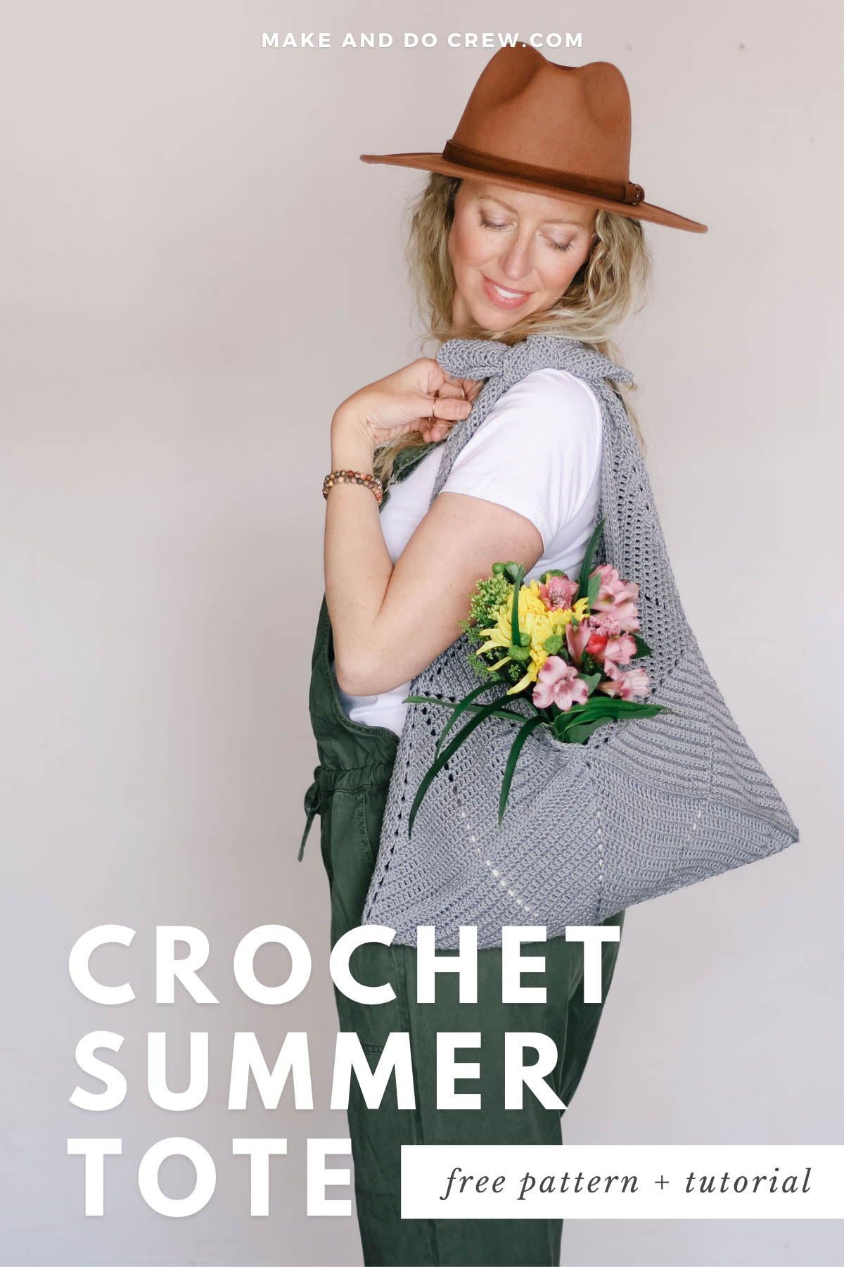 Woman carrying an over-the-shoulder origami crochet tote bag filled with flowers and made from 24/7 Cotton yarn.